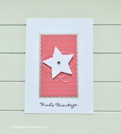 Eine Weihnachtskarte in der Farbkombination weiß, silber und rot.