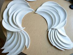 """DIY Angel Wings made with paper plates. Can use this design for tombstone """"Weeping Mourners"""" and paint with Drylok to waterproof them for outdoor use!"""