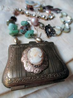 'little bronze purse' necklace by The French Circus on Etsy
