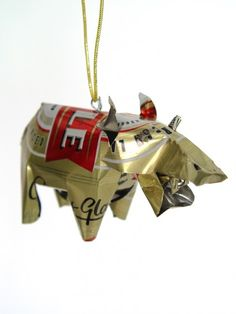 Unpainted Tin Hippo Ornament  $8.00. This smiling hippo is our newest unpainted tin ornament, made from recycled soda cans. Her friendly demeanor and eco-conscious material will both look and feel great on your holiday tree.
