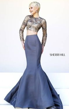 SHERRI HILL Prom Dresses 2015 # 32009 Dramatic mermaid skirt is distinct, yet complimenting in this unique two piece. The long sleeves on the nude crop top shine with large metallic pattern work.