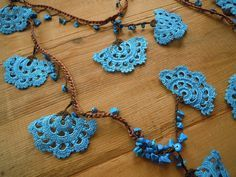 turquoise and brown crochet lariat necklace large by PashaBodrum Informations About turquoise and brown crochet lariat necklace, large fan shapes Pin You can easily use. Collier Lariat, Lariat Necklace, Tunisian Crochet, Thread Crochet, Bracelet Crochet, Crochet Earrings, Scarf Jewelry, Turquoise, Crochet Videos