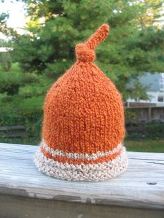 Knitted newborn orange and beige baby hat by BitsOfFiber on Etsy, $22.00