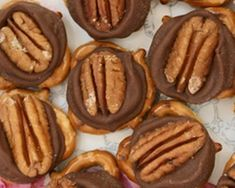 """Turtle """"cookies"""" made with 3 ingredients: pretzels, Rollos candy, and pecans.  Nice..."""