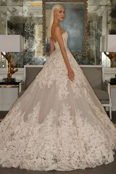 Internationally renowned Romona Keveza is an established leader amongst the world's top designers. Her latest 2015 bridal collectionshowcases the ultimate in couture workmanship with unparalleled fit. See the complete collection ofRomona Keveza wedding dresses below and happy pinning!