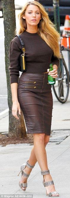 Gently does it: Blake expertly strode around the Big Apple set despite the fact she was in sky high silver sandals #hothighheelssexyoutfits