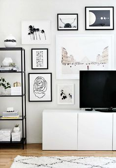 Gallery wall ideas hiding a tv using art around tv The Life Creative