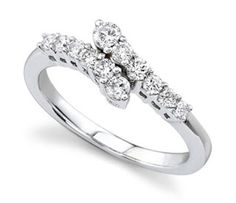 Beautiful right-hand ring!...sure to compliment any wedding ring! ;)