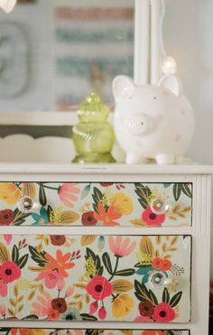 I love the little antique dresser that I refinished last summer with Rifle Paper Co. wrapping sheets in a similar technique I used with BBFrosch chalk paint powder, and mod podge like this hutch.