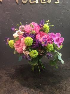 Wedding Bouquet: Cerise Pink Phaleanopsis Orchid, Lime Green Viburnum, Deep Purple Lisianthus, Cerise pink Peonies, Silver Brunia, Purple Clematis, Soft Pink Phlox, Eucalyptus