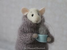 This funny little mouse is handmade from high-quality merino wool using needle felt techniques. You get it holding a porcelain cup (real