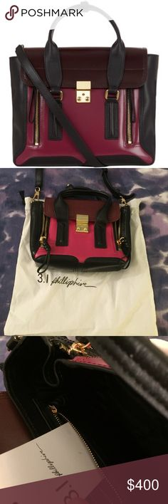 3.1 Phillip Lim Mini Pashli Bag Featuring the signature expandable sides and a long removable shoulder strap. Top carry handle; front flap closure; gold-tone push lock fastening. Contrast burgundy, black, and magenta trim; interior black lining. Internal zip pocket. 100% Leather. Dimensions: W: 23cm, H: 18cm, D: 7cm. Handle drop: 14cm, Strap drop: 62cm. I purchased this from the RealReal & was assured that its real, but that is the only verification that I have. Feel free to ask…