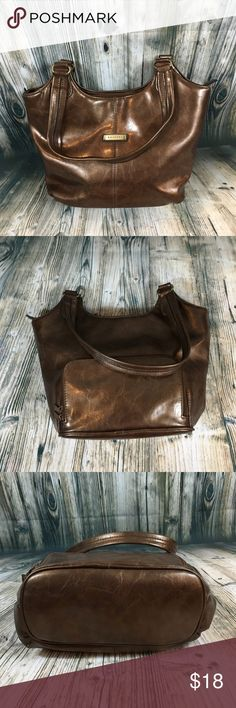 """Rosetti Bronze Medium Shopper Bag Sweetie!  Rosetti Bronze Medium Shopper Bag. Beautiful bronze color is perfect for you fall add on piece. Good used condition - slight signs of wear on zippers. Interior is clean and stain free. Zipper enclosure with dual strap. Brown fabric interior with 2 open pockets and a zipper pocket. Another zipper pouch is on the back of the bag.   14"""" x 9"""" x 4.5"""". Strap drop:  11"""". Bags Shoulder Bags"""