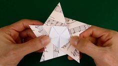 Folding a 5 Pointed Origami Star. Thanks to Coldplay's Target ad I totally am considering making a butt load of these to hang over the dance floor at the reception!