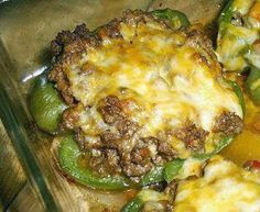 Stuffed Peppers Ingredients: 2 large green peppers, halved lengthwise 1 pound ground beef 1/4 cup onion, chopped, 1 1/4 ounces 1 clove garlic, minced 1/2 cup tomato, chopped, about 2 ounces Salt and pepper, to taste 4 ounces cheddar cheese, shredded 2 ounces cheddar cheese, shredded, for topping