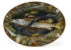 A French Palissy ware oval platter, Renoleau, Goras & Cie  circa 1897 -  Naturalistically modeled as a rocky pool centered by a fish and an eel, the molded foliate border applied with a lobster, two frogs, two fishes and shells, incised two towers above A and FG & Cie, painted F. Goras a M J. David(?) 24 Juin 1897. length 22 1/2in (57cm)