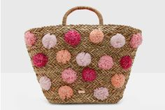 Ooh! We just spotted this playful woven trapeze pom pom bag from Ted Baker: a throwback to midcentury style, and perfect for summer.