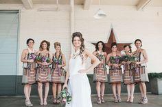 Love the striped bridesmaids' dresses with pom pom fringe!