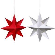Une boîte de 4 étoiles en papier à suspendre, en rouge ou en blanc - design : Louise Helmersen (Danemark)