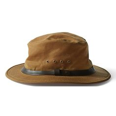 The Filson Tin Packer Hat is water repellent and wear resistant for repeated wearing. Interior cotton sweatband and side ventilating grommets add comfort.The Tin Packer Hat offers:Interior cotton sweatband for a comfortable fit Outdoor Hats, Outdoor Outfit, Outdoor Gear, Gaucho, Dark Tan, Hats Online, Cool Hats, Fancy Hats, Beanies