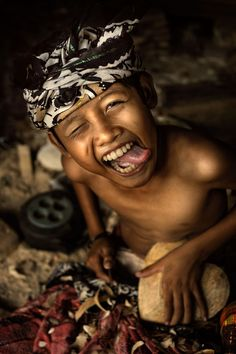 Bali boy woodcarving