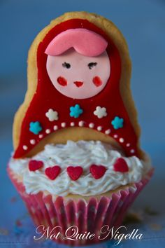 Matroyoshka Doll Cupcakes!  So cute! I will use my own cupcake recipe and my own sugar cookie recipe, too.