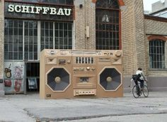 Cardboard Boombox by Bartek Elsner To promote International Radio Festival in Zurich, this giant cardboard ghetto blaster is secretly hiding a Mini inside which actually acts as a battery and powers the speakers to produce sound. Cardboard Sculpture, Cardboard Art, Sculpture Art, Paper Sculptures, Cardboard Design, Sculpture Projects, Cardboard Furniture, Cardboard Boxes, Art Projects