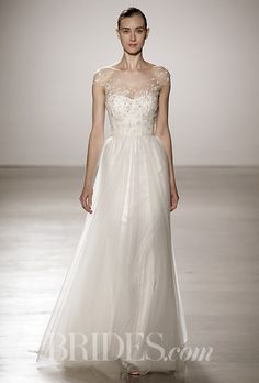 """Brides.com: . """"Hayden,"""" floral hand beaded bodice with soft tulle skirt, Christos"""
