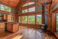 Log home interior with log, beam accents.