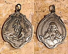 Large Antique Signed Holy Medal Scapular Jesus Virgin Mary  (Image1)Large size, rare signed Antique religious medal featuring the Sacred Heart of Jesus and The Blessed Mother Virgin Mary as Our Lady of the Guard.  Signed by master Argentinean engraver Constante Rossi whose work is represented in the Argentine National Collections and is known for his free form Art Nouveau designs.  Perfect larger size for a man