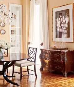 A work by contemporary Cuban artist Alejandro Montesino hangs above a 19th-century French marble-top bureau in the dining room.