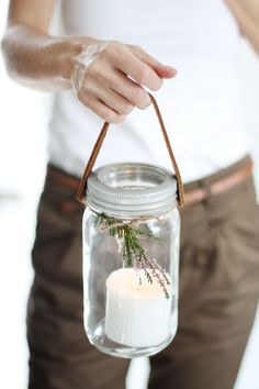 Could have mason jars outside, with sprigs attached... also could hang a few from the ceiling