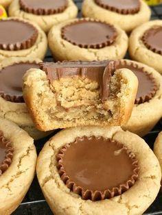 Peanut butter cookie cups filled with a Reese's chocolate peanut butter candy. Peanut Butter Candy, Peanut Butter Cup Cookies, Peanut Butter Recipes, Yummy Cookies, Reese Cup Cookies, Brownie Cookie Cups, Reese Cup Cookie Recipe, Hersey Kiss Cookies, Cool Cookies