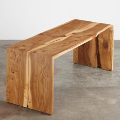 An English elm bi-fold table with a natural edge center reveal. We salvaged this tree in the Madison Park neighborhood of Seattle.