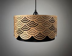 Love this standout lampshade with handcut wood detail. Like a golden dripped cake!