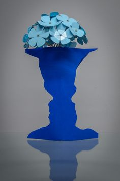 Zach's Vase: Called The Face Vase™, this design is inspired by the classic optical illusion that asks if you see a vase or two faces. The shape of the vase was created by tracing Zach and his wife Sarah's profiles.