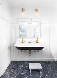 The vintage vibe of Kohler's Brockway trough sink led the design direction. Sunrise Specialty's clawfoot and pull-chain water closet complete the look. For a luxe touch, a metal plating shop stripped the faucets and soap dish to expose the brass.