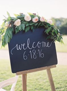 Welcome chalkboard wedding sign dripping in garland: http://www.stylemepretty.com/2016/09/10/blush-pink-pippin-hill-vineyard-wedding/ Photography: Michael and Carina - http://www.michaelandcarina.com/