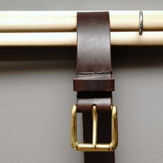 Leather unisex belt made from the same leather used in saddles - it will hold anything! Brass buckle from Denmark, leather from Italy. Best of the best! kinsaleleather.com