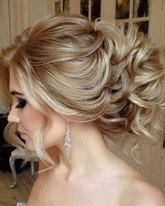 kıvırcık dağınık topuz gelin saçı modeli