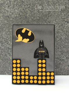 Lego Batman card. Details @ www.thepapercaper.com.au. Stampin' Up! Supplies: Undefined (hand carved Lego man stamp), Basic Black, Basic Gray, Crushed Curry & Daffodil Delight cardstock & markers, Word Bubble framelits...