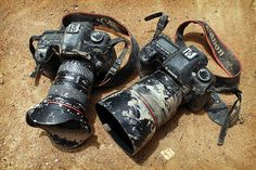 These belong to photographer Timothy Allen, who photographs the world's indigenous societies for the BBC documentary Human Planet. He uses two Canon 5D Mark II DSLR cameras with 16-35 f2.8, 50mm f1.2, 85mm f1.2, 200mm f2.8, and 400mm f4.5 lenses.