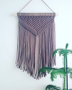 Available in three colors: taupe, white and beige (see my pictures) This handmade macrame wall hanging will add such a tasteful and stylish element to your home. Imagine how unique your space will look with this hanging in it. It looks great over chests, sideboards, TV benchs, sofas,
