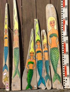 mermaid painted driftwood~ love their Hair...had to share :)