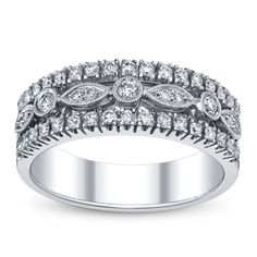 OOooo this Simon G Anniversary band would match my wedding set! So pretty!! Too bad it's $2860  Paisley Collection MR1174