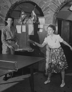 """Victory Belle Bunny Bekins plays ping-pong in Dallas. Location: Dallas, TX, US; Date taken: 1942; Photographer: John Florea. Featured in LIFE magazine June 29, 1942 article, """"USO In Peace and War It Has Proven Its Worth"""". 