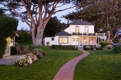 Mission Ranch owned by Clint Eastwood ~ The Farmhouse has six charming bedrooms, all with a queen bed and private baths (some have showers only). The cozy common living area offers a gas fireplace and is ideal for farmhouse guest gatherings. (no view)