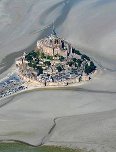 Mont St Michel, named after the Archangel St Michel, viewed either in drought and/or low tide? Places To Travel, Places To See, Le Mont St Michel, World Photo, Secret Places, Aerial View, Wonders Of The World, The Good Place, Beautiful Places