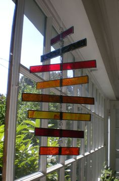 Stained Glass Spiraling Mobile by lostandfoundportland on Etsy Stained Glass Ornaments, Stained Glass Suncatchers, Stained Glass Designs, Stained Glass Panels, Stained Glass Projects, Stained Glass Patterns, Leaded Glass, Stained Glass Art, Mosaic Glass