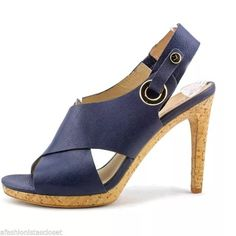 """NEW Via Spiga Dark Navy Blue Dress Cork Heels Open toe; ankle strap with loop and button closure and elastic stretch panel 4"""" heel, 0.75"""" platform Calf leather upper, leather lining, leather sole Condition: New without box!  This item is directly from a large department store & 100% authentic. Item may be a close out, shelf pull, return, store overstock or seasonal over stock. We inspect all merchandise and try to show all quality detail in the pictures and descriptions.   Retails $250 plus…"""